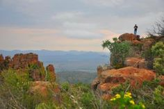 Camdeboo National Park in the Eastern Cape Province offers these spectacular views: http://eagerjourneys.com/graaff-reinet-2/
