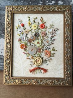 My hand embroidered Antique Button Bouquet. For sale on etsy.com at warnANDweathered