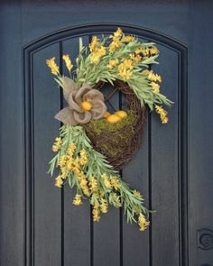 Looking for a new Twist??? Love it! Fun...fun...fun  I used an 16 inch oval basket wreath and filled it up with spanish moss, soft green