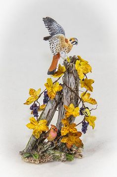 Miniature sculpture of a  Kestrel landing on by MaryMcGrathStudio