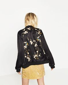Black floral embroidery bomber jacket Available at Pasa Boho. Wholesale and retail all welcome. Fashion trend and styles from hippie chic, modern vintage, gypsy style, boho chic, hmong ethnic, street style, geometric and floral outfits. We Love boho style and embroidery stitches. Free Spirit hippie girls sharing woman outfit ideas. bohemian clothes, cute dresses and skirts.
