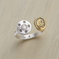 SIDE BY SIDE RING--Parallel universes in brass and Thai silver sit side by side on the finger; sterling silver U band below. Handcrafted Sundance exclusive. Whole sizes 5 to 9.