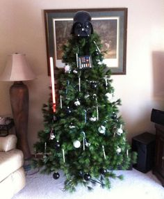 Christmas tree with a Darth Vader mask and light saber ornament, a very Star Wars holiday tree. Star Wars Christmas Tree, Darth Vader Christmas, Angel Christmas Tree Topper, Unique Christmas Trees, Christmas Angels, Xmas Tree, Christmas Tree Decorations, Christmas Time, Christmas Crafts