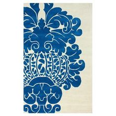 Hand-tufted wool rug with oversized damask motif.  Product: RugConstruction Material: 100% WoolColor: BlueFeatures:  Made in IndiaHand-tufted Note: Please be aware that actual colors may vary from those shown on your screen. Accent rugs may also not show the entire pattern that the corresponding area rugs have.Cleaning and Care: Spot treat with mild detergent and water. Professional cleaning is recommended if necessary.