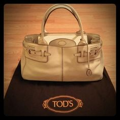 """TOD'S Authentic Leather Satchel Genuine Leather (LP14) Off-white Lots of room inside One inside zipper pocket Magnetic closure Leather is in excellent condition Inside bottom has a spill spot on very bottom (see pic 4), otherwise, excellent condition Dust bag included Made in Italy  No Trades - No Low Balling  ⓂFront across:  15"""" ⓂBottom: 16""""W,  7""""D ⓂTop of handle-bottom:  15.5"""" Tod's Bags Satchels"""