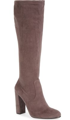 A stretchy sueded shaft tops this almond-toe boot lifted by a slightly squared, towering heel.