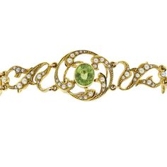 The bracelet comprises of eight articulate panels, five of which are foliated, including the snap. The three central panels are adorned with a bezel centre setting with the pearls bead set into typical Art Nouveau swirls. The feature of the pendant is the oval cut, green peridot. Circa 1890-1900.
