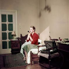 Robert Capa's Stunning Color Photographs: Capucine, French model and actress, in her hotel room, Rome, August 1951
