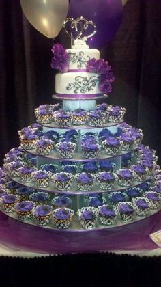 so what do you think about the cupcake tower, but with a little cake on top for tradition? More from my site purple turquoise cupcake tower Fondant Cupcakes, Purple Cupcakes, Wedding Cakes With Cupcakes, Cupcake Cakes, Sweets Cake, Purple Wedding Cakes, Cool Wedding Cakes, Wedding Cake Designs, Birthday Cakes