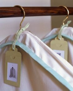 photos tucked into card-stock tags with windows identify the contents inside garment bags, which can be easily made from pillowcases including body-sized for long dresses