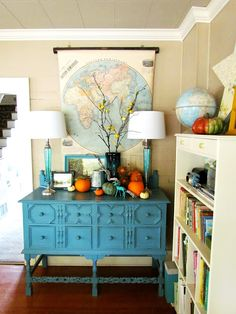 Fall vignette... love how the orange pumpkins look with the turquoise pieces in the room! From Trisha Brink Design #Fall