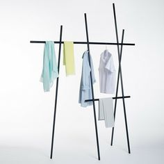 Super cool clothing rail. Creative and attractive - looks nicer than the ol' Hills Hoist, but less practical.. 9-degrees-by-Martha-Schwindling