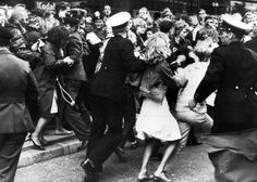 4,000 Beatles fans gathered in the streets around the Royal Hotel in Copenhagen, Denmark, several hours before the British pop group, The Beatles, arrived on June 4, 1964. Danish police try to hold back the fans from rushing the hotel.