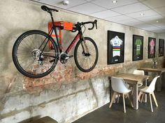 Bike Storage on the wall by Cafe VillaVelo. Stylish way to hang your bike on the wall like a work of art. The best bike wall mount solution. Indoor Bike Rack, Indoor Cycling, Best Road Bike, Road Bikes, Velo Shop, Wall Mounted Bike Storage, Bike Hotel, Ridley Bikes, Bike Wall Mount