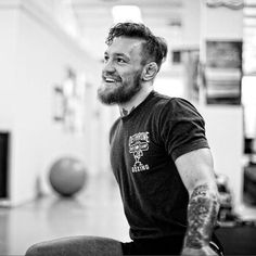 candid B&W smiling picture of Conor McGregor : if you love #MMA, you will love the #MixedMartialArts and #UFC inspired gear at CageCult: http://cagecult.com/mma
