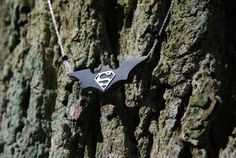 Batman vs Superman necklace. Ebony wood and sterling silver.