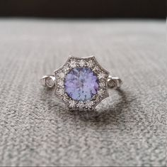 Hey, I found this really awesome Etsy listing at https://www.etsy.com/listing/287140501/upgraded-halo-tanzanite-diamond-ring