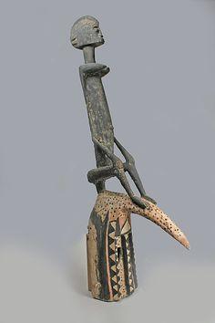 Mask: Hornbill (Dyodyomini)  20th century Geography: Mali Culture: Dogon peoples Medium: Wood, pigment Dimensions: H. 39 1/2 x W. 7 x D. 15 7/8 in. (100.3 x 17.8 x 40.3 cm)