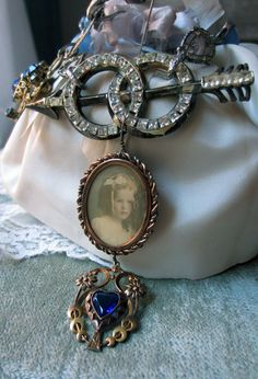 'girl with a blue heart' necklace by The French Circus on Etsy