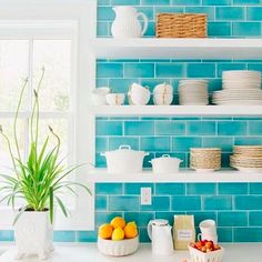 #COLOR TIP: the more colorful the backdrop, the whiter the shelves and cabinetry. I love this blue against the bright white giving this #kitchen a beautifully crisp #design!