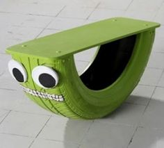 Children's outdoor seesaw using a board & car tyre  #recycledtyre