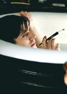 Ben Whishaw smoking in the tub like a boss