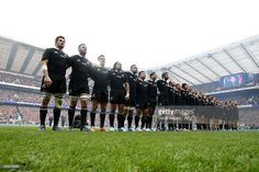 The New Zealand team line up for the national anthems prior to kickoff during the QBE...