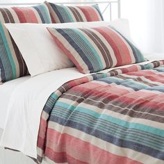 """A new spin on our Treehouse Linen bedding, this linen duvet cover, featuring earthy stripes in shades of indigo, sky, and crimson, is a tribute to New England sunsets.   • 100% Linen.  • Knife edge.  • Envelope back closure with 4"""" overlap and ties."""