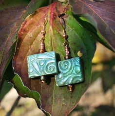 mystic green earrings with iridescent foil by purplecactusstudios, via Flickr