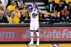 Stephen Curry of the Golden State Warriors reacts from the bench in Game 1 of the 2017 NBA Finals against the Cleveland Cavaliers at ORACLE Arena on...