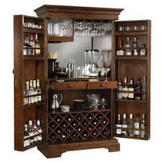 - Features - Specifications - Shipping & Returns - Warranty - About Manufacturer - Finished in Americana Cherry on select hardwoods and veneers. - This Hide-A-Bar cabinet features a raised door panel