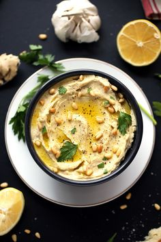 Artichokes + leeks are cooked and blended into this ultra-creamy white bean hummus.