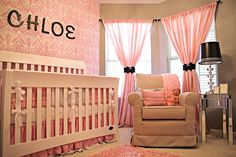 Chloe's Room big windows with the pink curtains and black ties! Also love the wall paper!