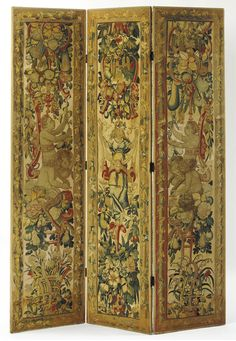 A FLEMISH TAPESTRY COVERED THREE-FOLD SCREEN THE TAPESTRY CIRCA 1600 woven with frolicking fawns amidst trelliswork