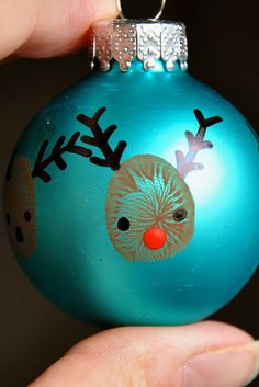 Adorable thumb print reindeer ornament