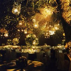 My dream wedding would be in the middle of the forest at night lit by hundreds of hanging candles :-) omg yes