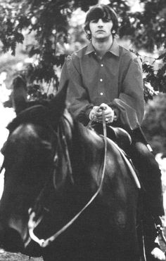 Ringo Starr on a horse.