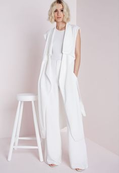 Get elegant summer style with this chic, white Missguided Sleeveless Belted Waterfall Duster. Outfit idea: layer over a figure flattering nude bodycon and matching strappy heels for a totally luxe, fashionable finish. White Vest Outfit, Long Vest Outfit, Vest Outfits, Sleeveless Duster, Sleeveless Blazer, Western Outfits, Nyc Fashion, Fashion Outfits, Inspired Outfits