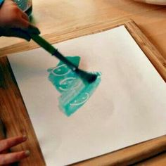 Draw a secret picture with white crayon, then paint over it to reveal.