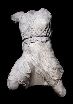 In a miracle of carving, the messenger goddess Iris appears to personify the very spirit of the air in which she moves. Her bronze wings, now missing, soared above her. Drapery can reveal as much as it conceals, often to erotic effect. Here, her flimsy tunic presses against her breast and abdomen while fluttering out to the sides. The figure represents the power of the great stone workers of the Parthenon in Athens to breathe vitality into cold marble.