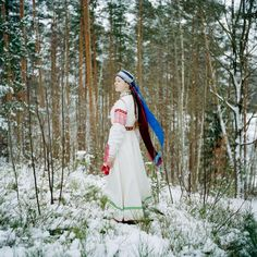 In Obinitsa Estonia a young Seto girl named Liisi Lõiv wears a traditional costume in her grandparents' garden. By Jérémie Jung. [710x710]