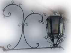Rustica House traditional outdoor lantern was hand crafted of hammered iron. The lantern is available with oxidized finishing, unfinished or painted black. Candle Sconces, Wall Sconces, Rustic Wall Lighting, Hotel Foyer, Hacienda Homes, Outdoor Lantern, Metal Tins, Spanish Style, Ceiling Lamp