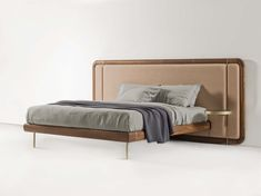 Killian bed by Porada in solid canaletto walnut, brass and upholstery. On the way to Graye LA for display in the fall of 2018!