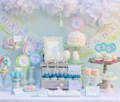 april showers bring baby flowers baby shower birthday printable flower set dessert table with blue sky backdrop accented with white cloud tissue poms