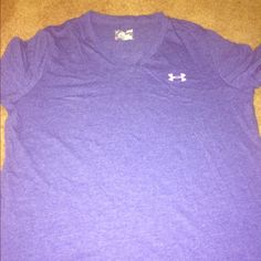 Under Armour workout shirt Purple under Armour workout shirt in a cotton blend that's been treated to be a more tech type shirt. It's purple v neck with a saying on the back. It's a loose fitted shirt. New but without tags, purchased but never wore. Under Armour Tops Tees - Short Sleeve