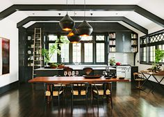 Kitchen with black cabinets and rolling library ladder - designer: Jessica Helgerson - photo by Lincoln Barbour - NYTimes.com