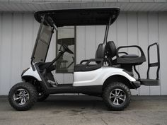 Though you see a lot of custom lifted E-Z-GO golf cars around, in most places, custom Yamahas are still relatively rare. But not in Vandalia, Ohio; we customize lots of Yamaha golf cars, and a great example is this street ready Yamaha DRIVE gas golf car in Moonstone Metallic equipped with 3-inch lift, premium lights, folding windshield, Elite Max5 rear flip seat, two-tone custom seat covers, rear view mirror, Line-X top, aluminum wheels, and more!