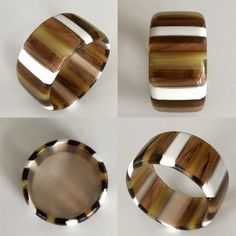 Vintage 1960's wide striped lucite bangle from the Best Plastics Factory in Rhode Island. The bangle measures 1 1/2 inches wide, inside opening is 2 1/2 inches and thickness approximately 1/4 inches. Excellent vintage condition.