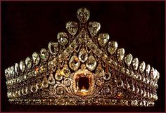 The Great Imperial Crown, made in 1762 for the coronation of Catherine the Great.  It is adorned with five thousand diamonds arranged in a splendid pattern of laurel wreaths and oak branches.     The glitter of the diamonds is enhanced by two rows of gleaming pearls and the crown is topped by a huge red spinel, the second largest in the world, which weighs almost 400 carats.