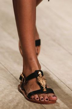 Vogue culls the key shoe styles of the spring/summer '14 season. Valentino's gold-detailed black leather sandals are sure to be instant classics.